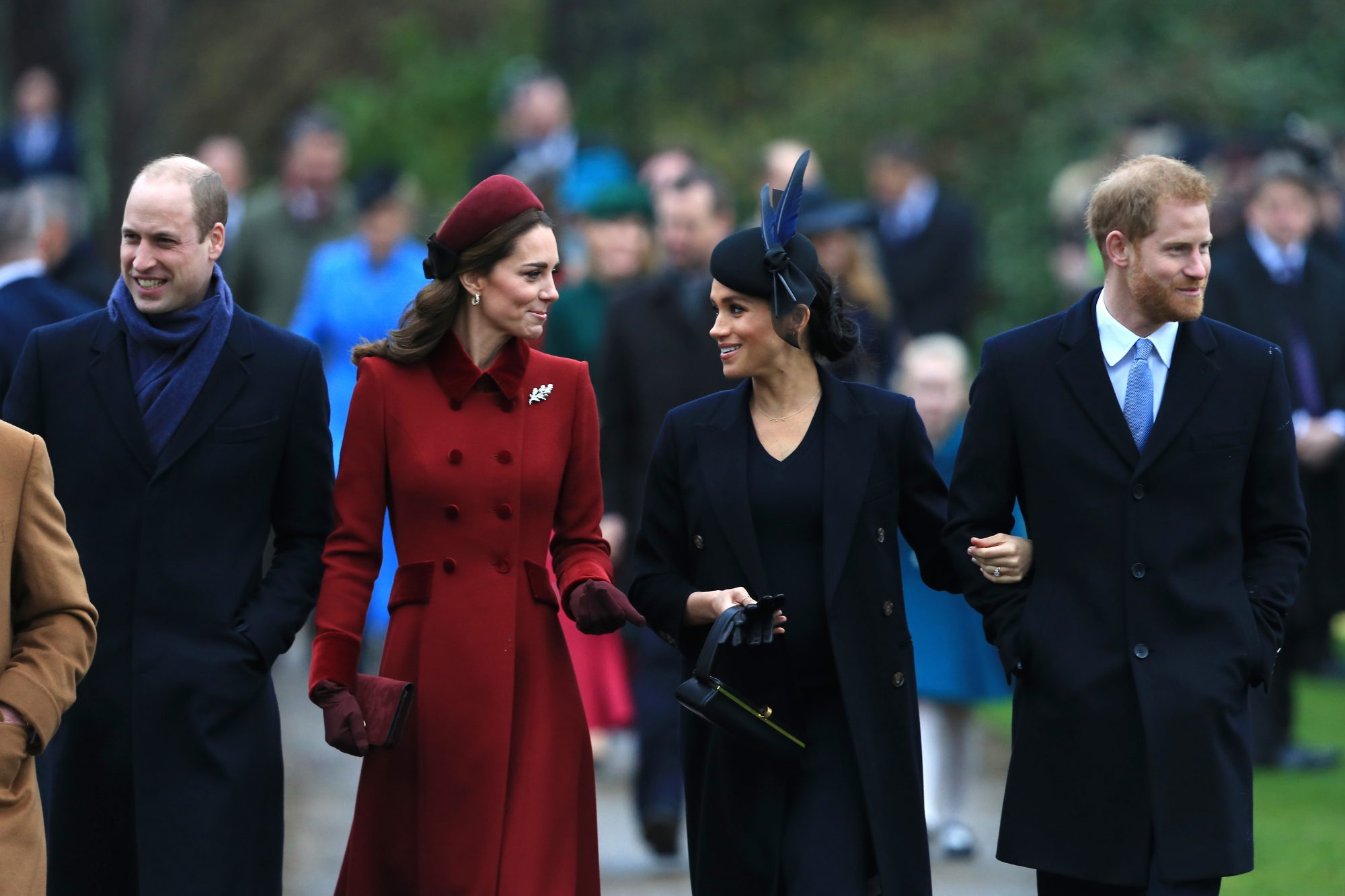 Prince William, Kate Middleton, Prince Harry, and Meghan Markle walking next to each other