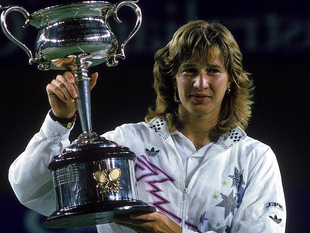 Steffi Graf raises the trophy after winning the Australian Open