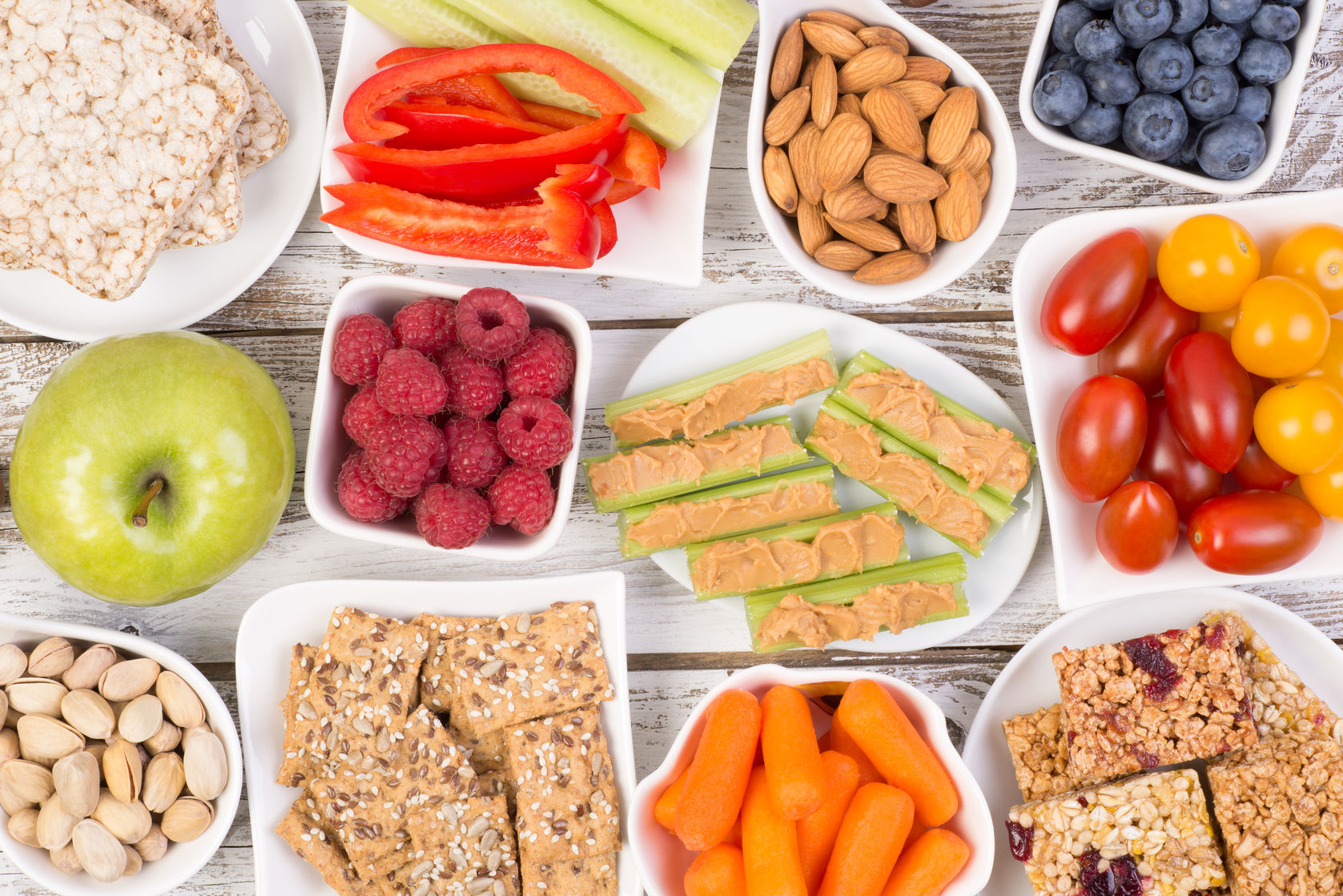 healthy snacks on wooden table, top view