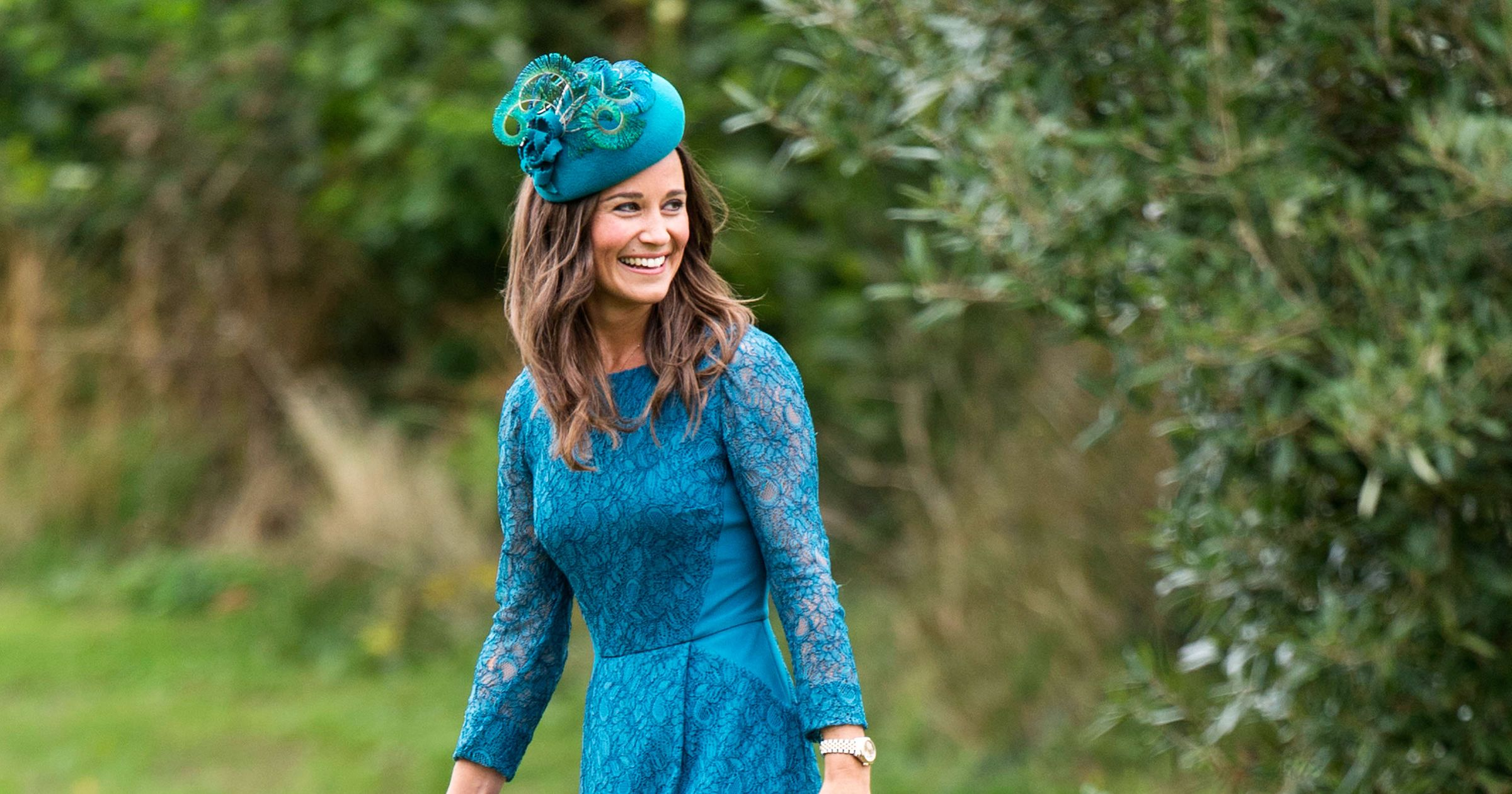 Pippa Middleton in a blue formal dress with a matching hat out in the open