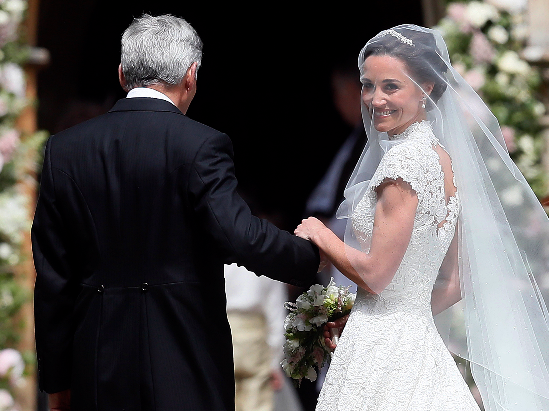 Pippa Middleton as a bride on her wedding day smiling under the veil