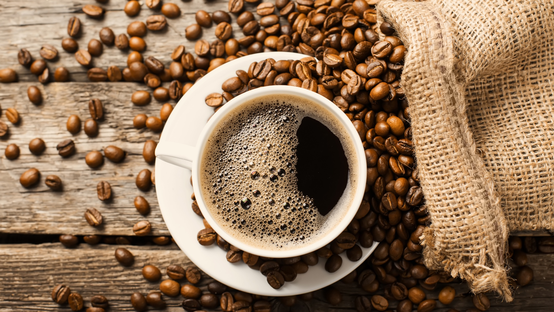 A cup of decaffeinated coffee pictured from above