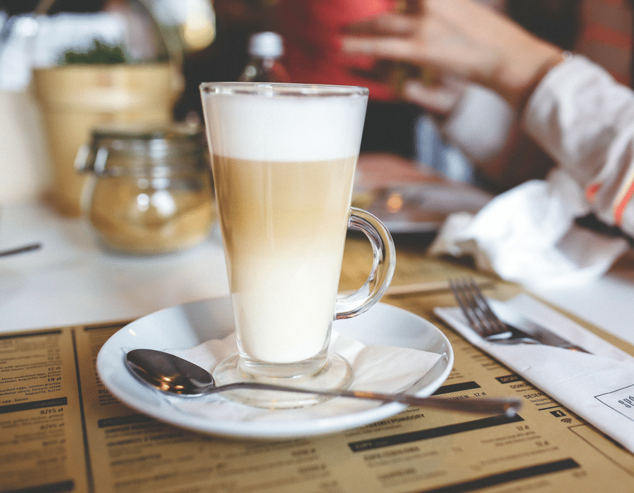 A tall glass of latte
