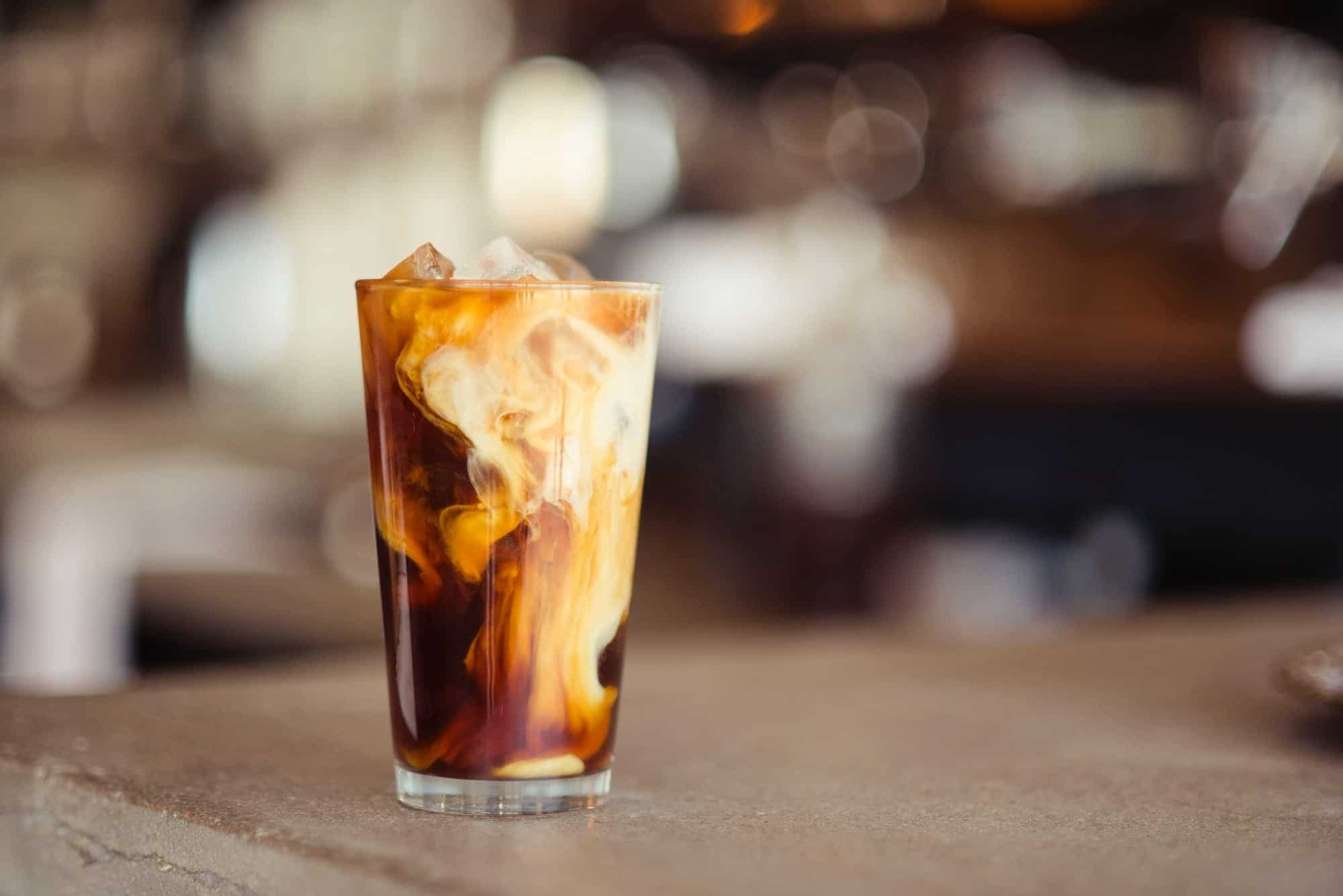 A tall glass of iced coffee