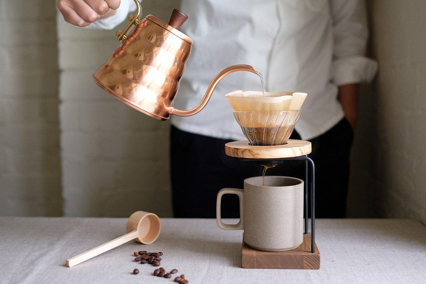 Man making drip coffee