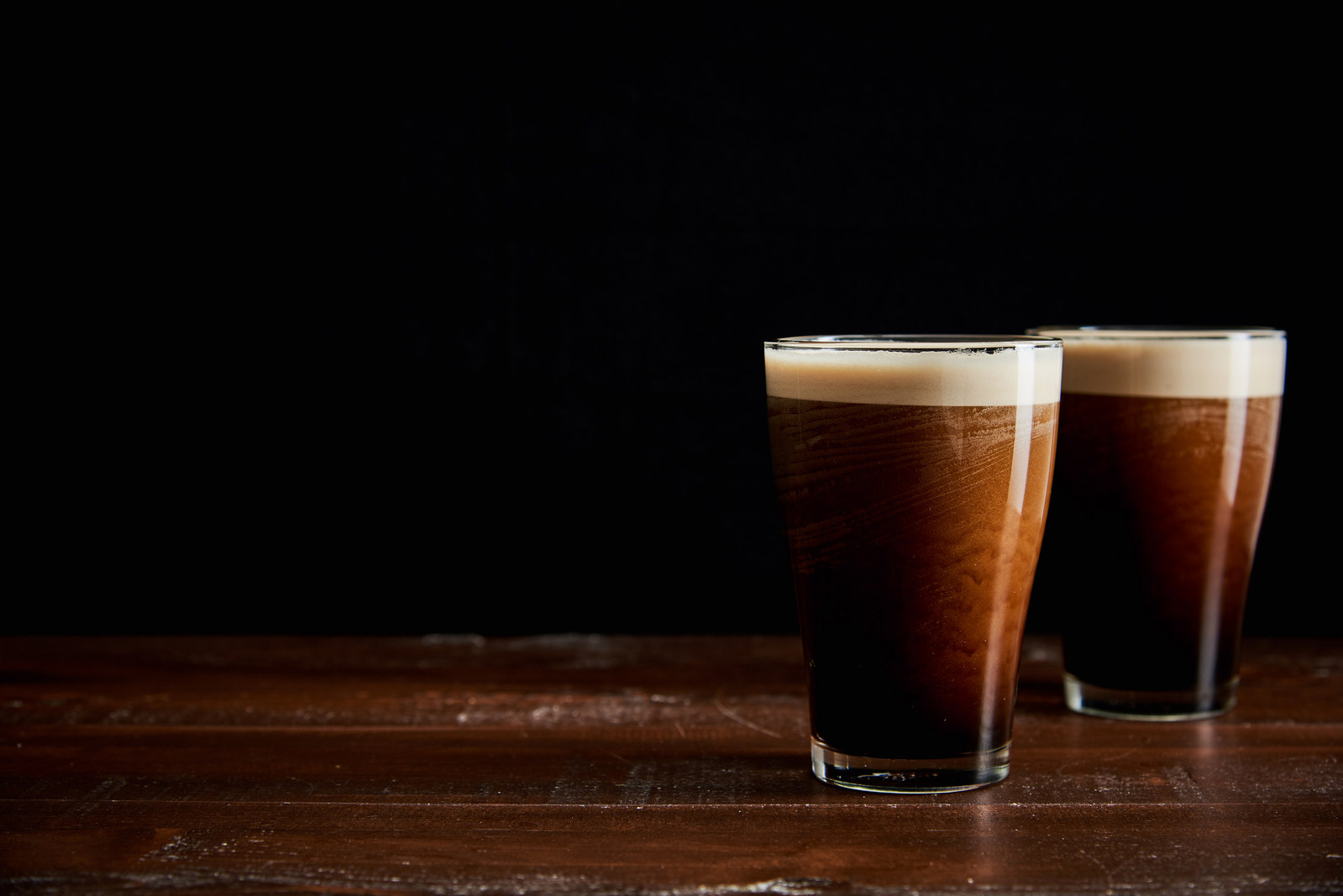 Two tall glasses of nitro cold brew coffee