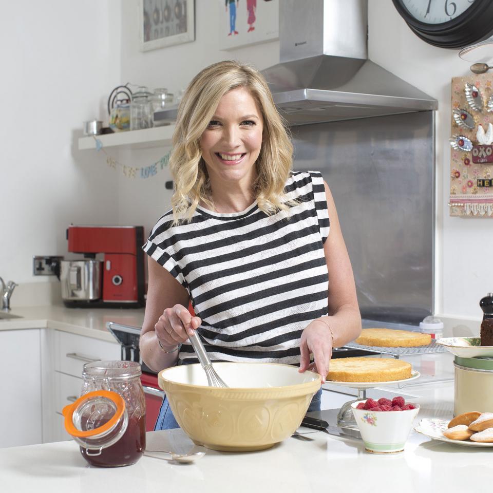 Lisa Faulkner whisking something in the kitchen