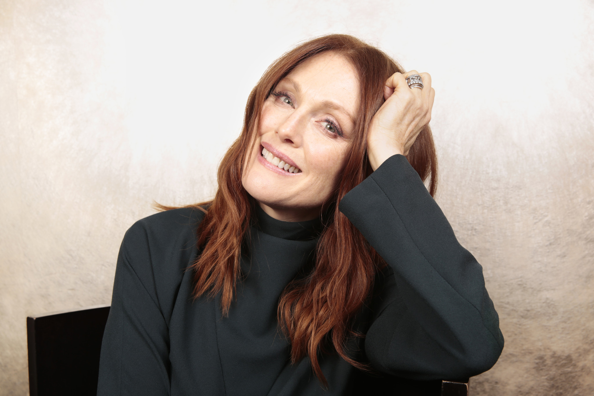 Julianne Moore dressed casually, smiling at the camera
