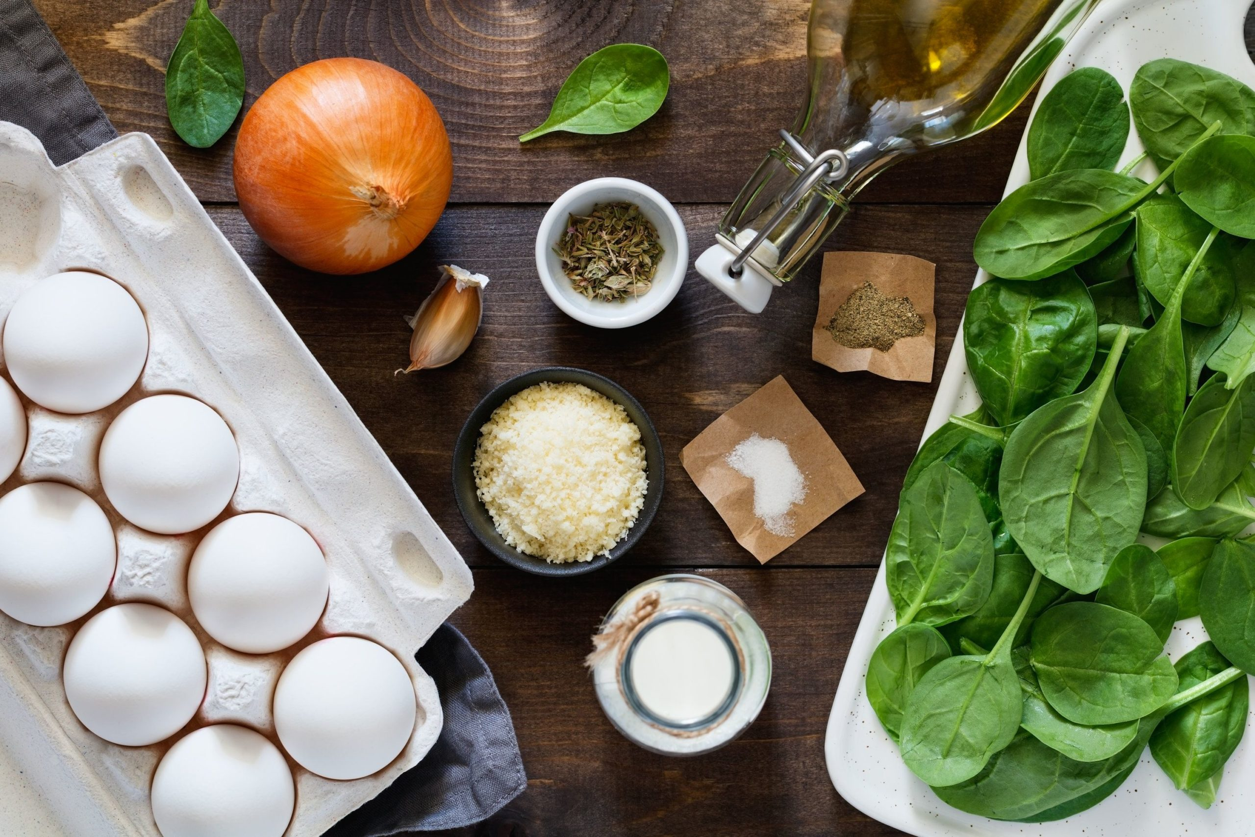 Ingredients for making scrambled eggs with baby spinach