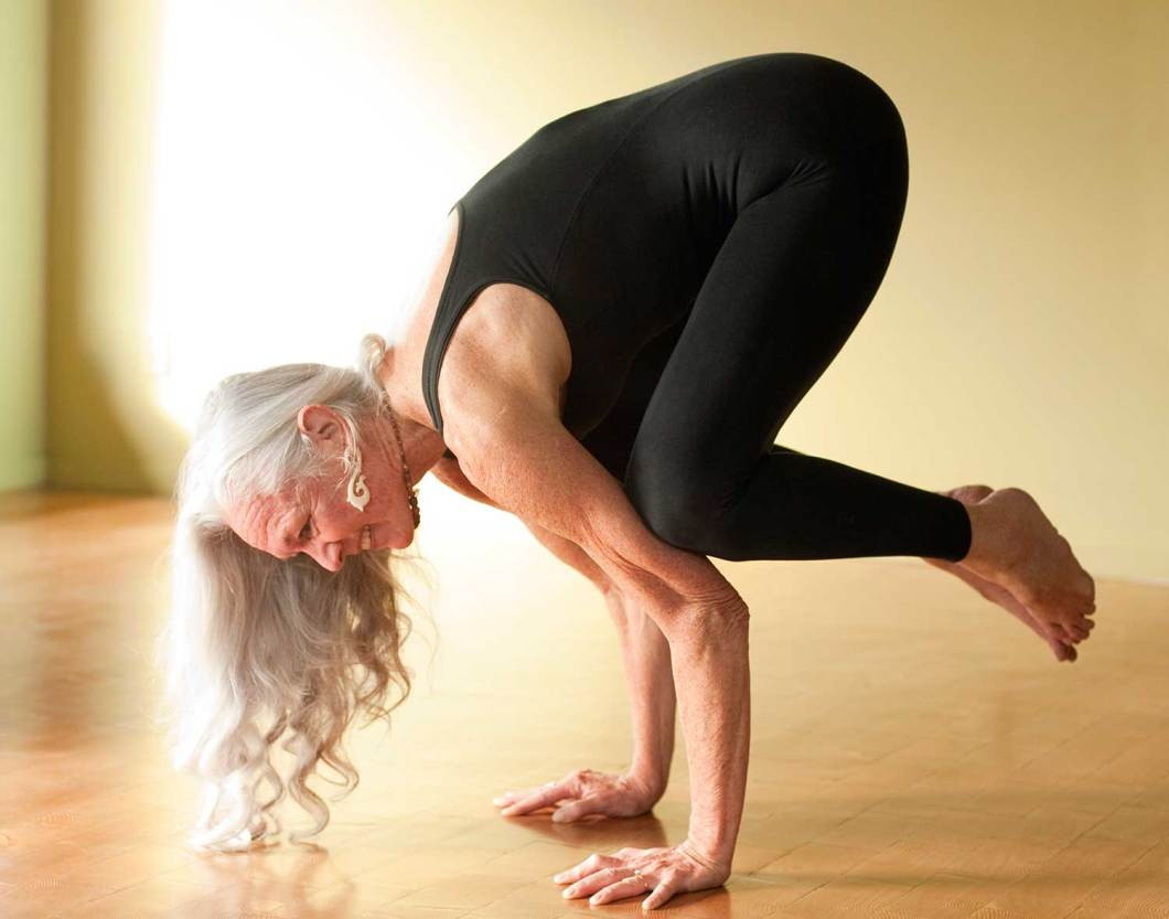 Older woman balancing her body on her two hands