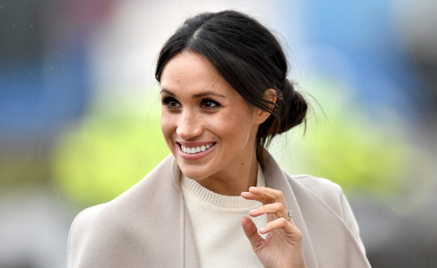 Meghan Markle smiling, waiving at the camera