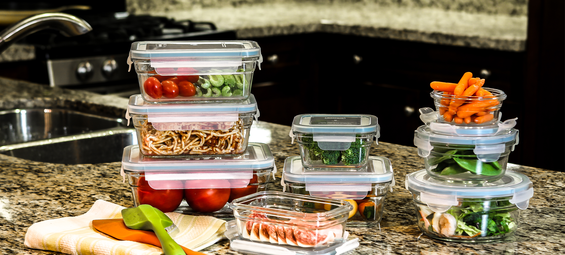Clear food storage containers arranged on a countertop