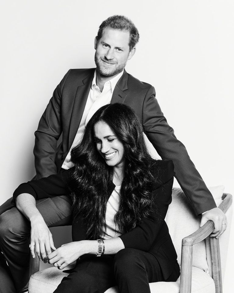 Prince Harry and Meghan Markle posing for a black and white portrait