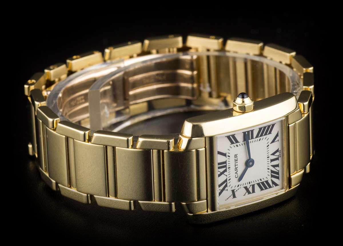 A gold Cartier Tank Française watch