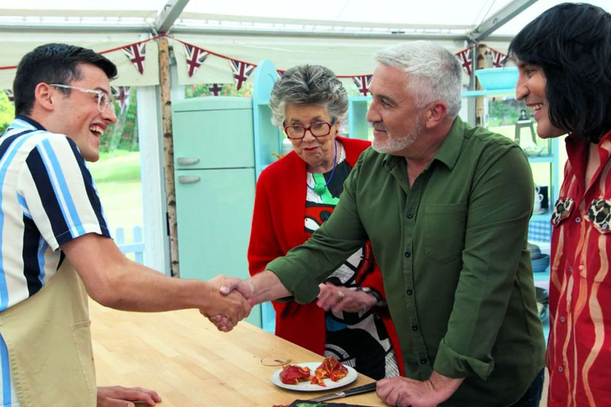 Paul Hollywood's signature handshake to a contestant from a previous season of Bake Off