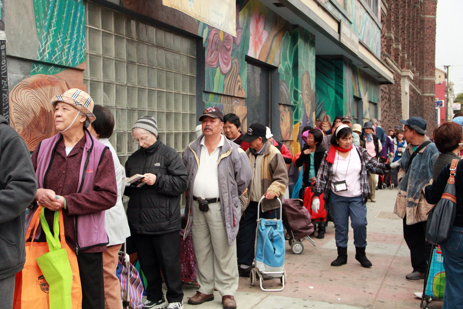 People queueing outside the Food Pantry