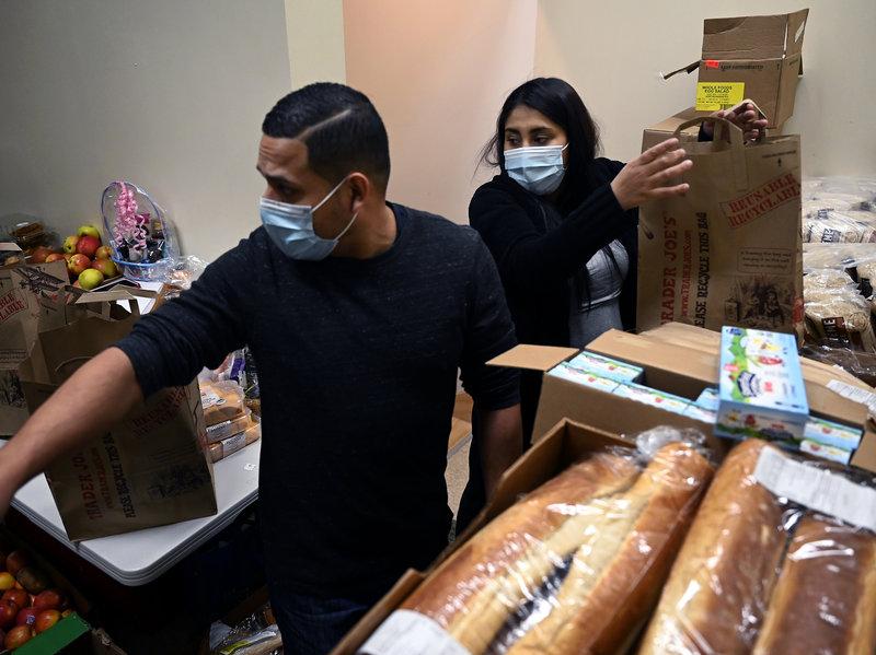 Riveros and De la Cruz Distributing Food