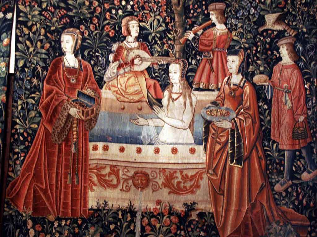 Bathing in the Middle Ages, maids offering perfumes and cleansing ointments to a woman