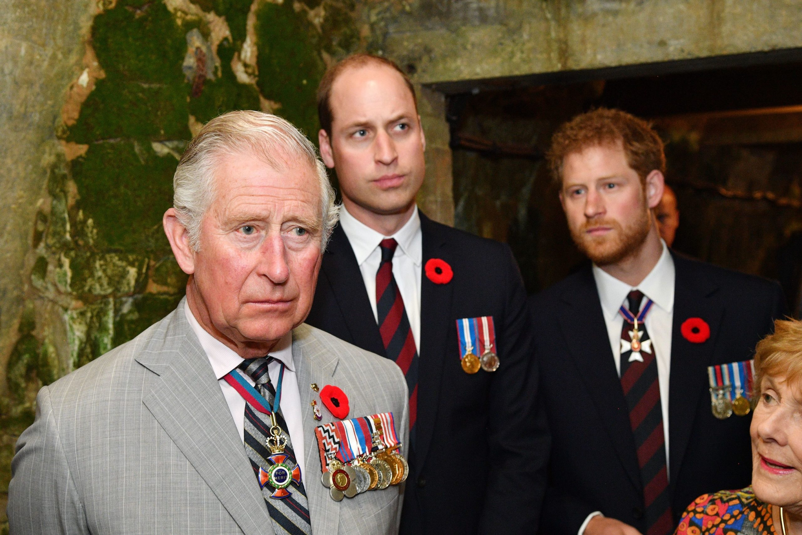 Prince William and Prince Harry standing next to their dad, Prince Charles