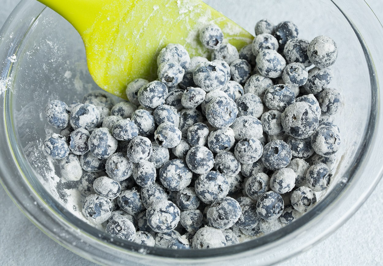 Blueberries in a bowl with flour