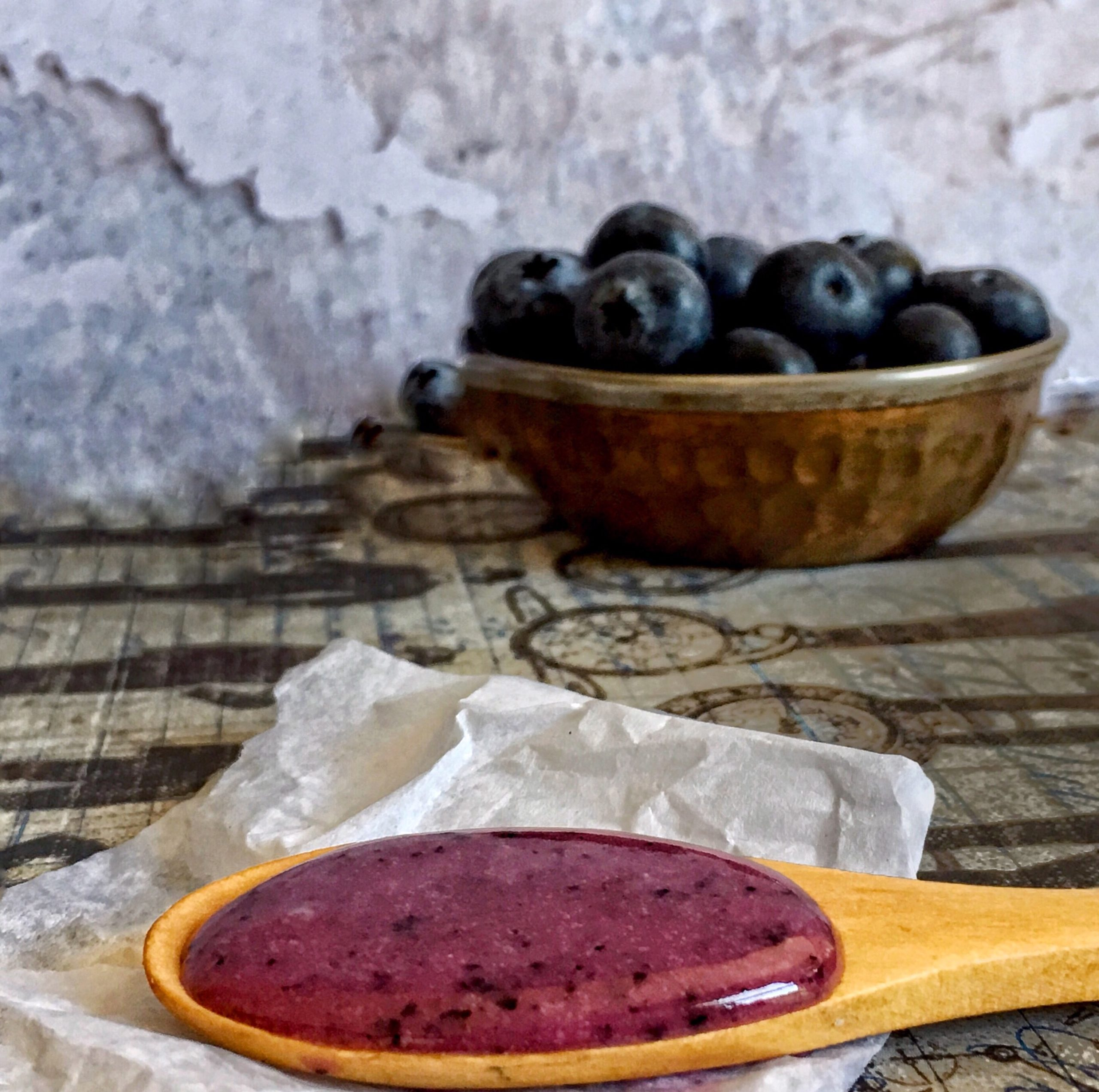 Blueberries and a spoon of blueberry glaze